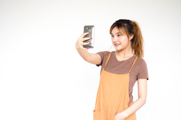 Beautiful young adult thai chinese bronze hair using her smart phone Selfie