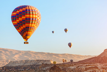 Colorful Hot air balloon flying over rock landscape at Cappadocia Turkey