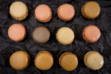 French macaroons cookies on black background.
