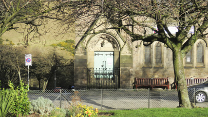 Old Church and square garden at Edinburgh city, Scotland, UK