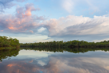 Colorful clouds at sunset over the Autana river, in the amazonian jungle, in Venezuela