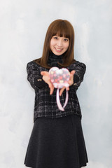 A portrait of Japanese girl have Valentine's Day present. (バレンタインデーイメージ チョコレートを持つ女性)