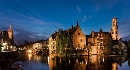 Bruges is a beautiful and characteristic town in Flanders (Belgium). The view in a gloomy atmosphere due to the bad weather keeps its charm and character in its historical architecture.