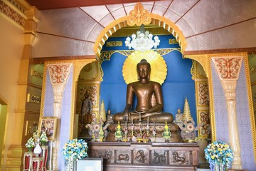 Bronze Buddha Sculpture in Sitting Meditation Form at Wat Pa Siri Wattana Wisut in Nakhon Sawan Province
