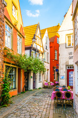 Keuken foto achterwand Smal steegje People are strolling through Schnoor district in Bremen, Germany.