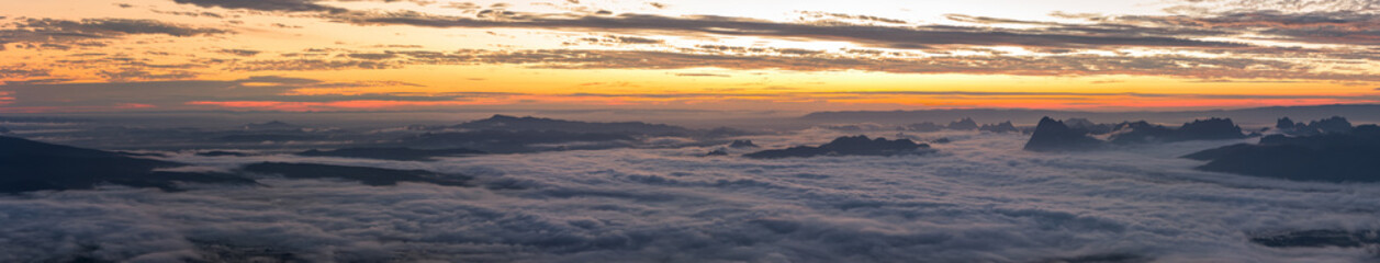 Panoramic of the rainy season with foggy at morning, Mountain top view of sunrise landscape in the rainforest, Thailand