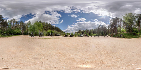 Panorama in open air museum of armored vehicles partisan camp.  Full 360 by 180 degree seamless spherical panorama in equirectangular equidistant projection. VR AR content