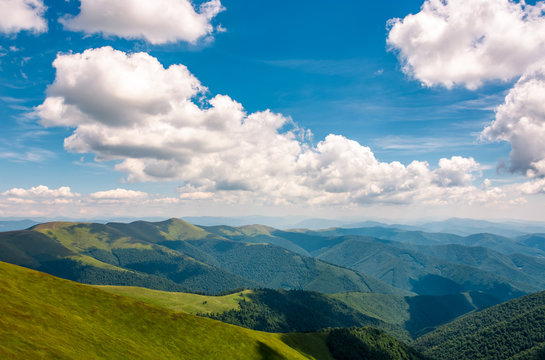 Carpathian mountain ridge with its spurs under sky with clouds. beautiful summer nature scenery