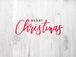 Wall Mural - Festive Merry Christmas Calligraphy Text Over White Rustic Wood Background