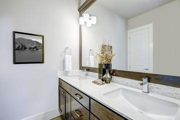 Lovely bathroom with dark brown vanity cabinet
