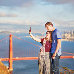 Romantic loving couple making selfie in San Francisco, California, USA