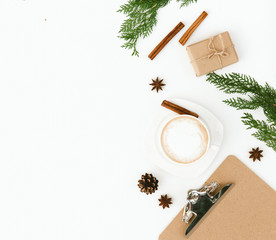 Christmas flat lay composition with cup of coffee over white background