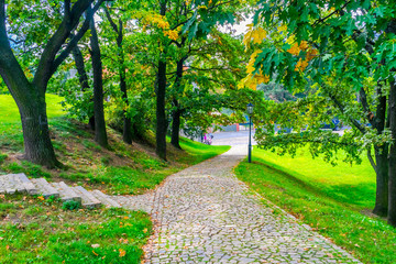 Tracks and lantern in the Vysehrad Park in Prague in the Czech Republic in the fall