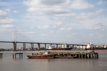 QEII Bridge over the River Thames with barges