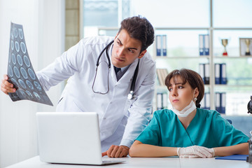 Two doctors discussing x-ray MRI image in hospital