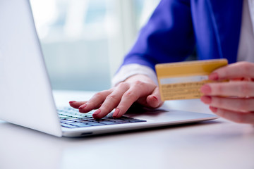 Woman buying online with credit plastic card
