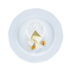 Camembert cheese on plate over white, with path