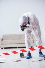 Forensic expert at crime scene doing investigation