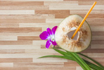 young coconut on wood background top view