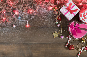 Christmas background, light and gift box  on old wood