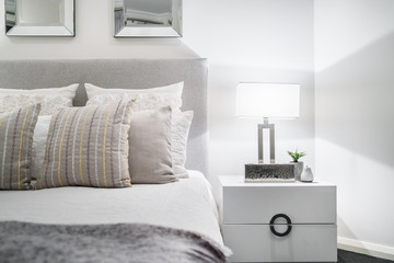 Bedroom setting with lampshade and light coloured decor in a modern Australian home.