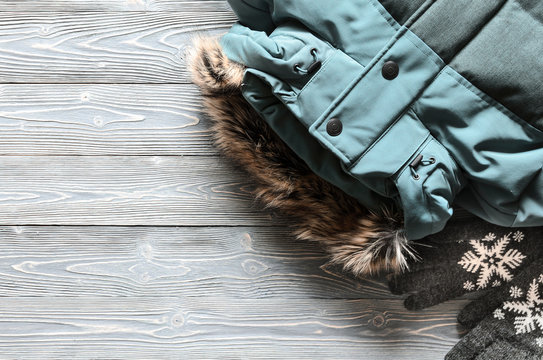 Women's warm winter clothing and accessories  - jacket and gloves. Wish list or shopping overview concept.  Fashion concept. View from above. Flat lay