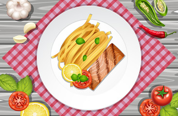 Salmon steak and pasta on the plate