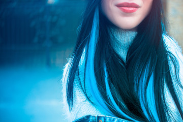 Girl with blue locks in her hair. Fashionable hair among young people or teenagers