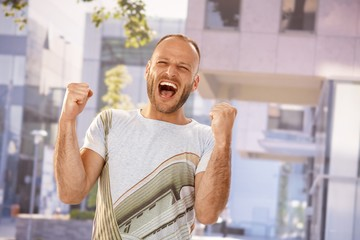 Stressed man shouting outdoors