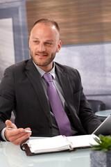 Businessman with personal organizer