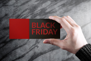 Black Friday Promotional Concept, Woman holding a Discount Coupon with Blank Space for Text