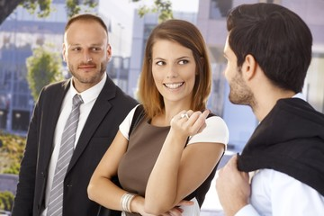 Attractive businesswoman flirting with colleague