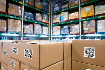 Smart logistic industry 4.0 , QR Codes Asset warehouse and inventory management supply chain technology concept. Group of boxes in storehouse can check product inside and order pick time. Wall mural