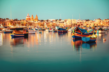 beautiful european harbor with maltese yacht and boat luzzu, village of Marsaxlokk, vintage toned style