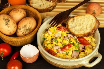 Scrambled eggs with herbs, simple, full protein breakfast with fresh herbs. Bio eggs from domestic breeding. Healthy food.