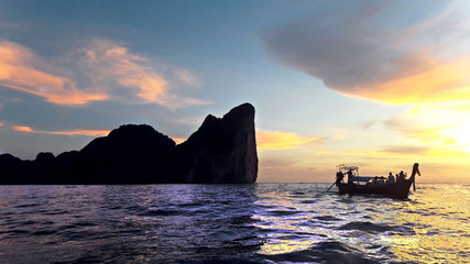 people on the boat in the ocean near the Phi-Phi-Leh island watching the sunset