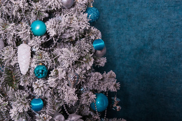 christmas tree decoration on blue background with copy space.