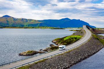 Caravan car RV travels on the highway Atlantic Ocean Road Norway.