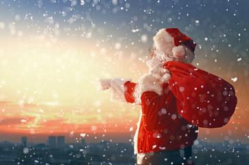 Santa Claus looking at city