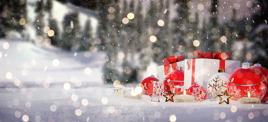 Red and white christmas gifts and baubles on snow 3D rendering