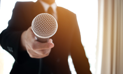 Journalists filing microphone interviewing to businessman. Smart Reporter taking interview and speech with microphone at presentation in conference, Business seminar concept