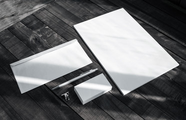 Brand identity template. Photo of blank corporate stationery set on wooden table background.