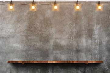 Wall Murals Wall Empty brown wood plank board shelf at grunge concrete wall with light bulb string party background,Mock up for display or montage of product or design
