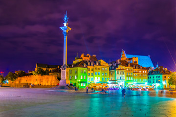 Night view of the castle square in front of the royal castle and sigismund´s column in Warsaw,...