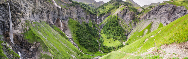 Wall Mural - panorama view of natural amphitheater with five waterfalls in the Weisstannen Valley in the Swiss Alps