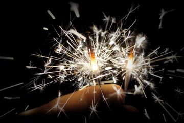 hand holding sparklers sylvester