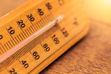 hot day summer concept closeup thermometer with warm color tone