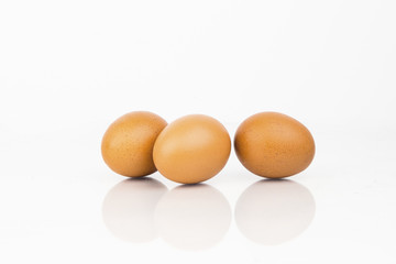 Fresh Organic Eggs On White Background With Reflection