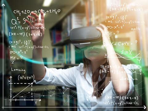 Asian woman wearing virtual reality glasses or VR headset and learning from technology. woman getting experience using VR-