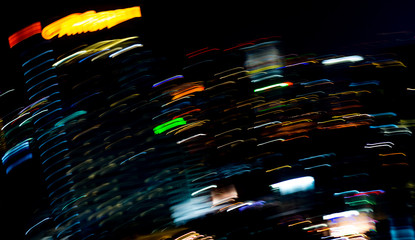 Beautiful lighting of Night futuristic line LED building abstract, Shooting style light color blur in Swirled night lights busy city abstract background. Movement of origin of multi colored lights.